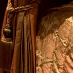 Detail of drapes on the four poster bed